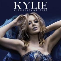 A Christmas Gift von Kylie Minogue – gratis MP3 Downloads - Eine Frau posiert für ein Bild - Kylie Minogue