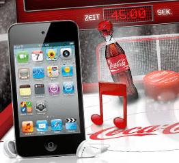 MacBooks und iPods beim Coca Cola Cokefridge Gewinnspiel - Ein Screenshot eines Mobiltelefons auf einem Tisch - IPod Touch
