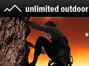 15 Euro Gutschein von Unlimited Outdoor - Eine Person, die in der Dunkelheit aufspringt - Klettern