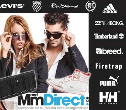 Modegutschein bei DailyDeal für MandMDirect.de - Eine gruppe von menschen posiert für die kamera - Brille
