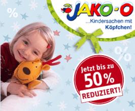 5 € Rabatt-Gutschein für Jako-o Neukunden - Ein Baby mit einem Schild - Kuscheltiere & Kuscheltiere