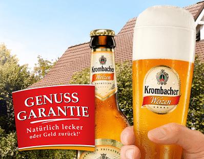 Bier umsonst: Krombacher Weizen - Eine Hand hält eine Flasche - Weizenbier